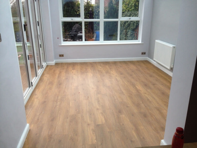 Amtico tiles installed in a brand-new conservatory in Cheadle Hulme