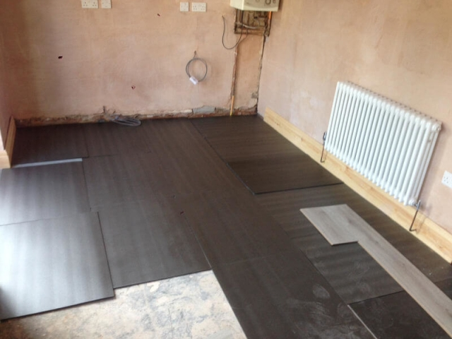 Korona Swiss advanced 8mm laminate being fitted to a kitchen in Poynton