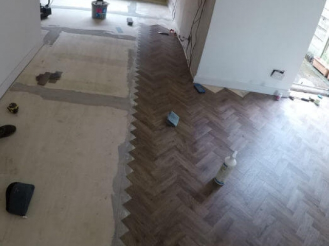 New Parquet flooring being fitted