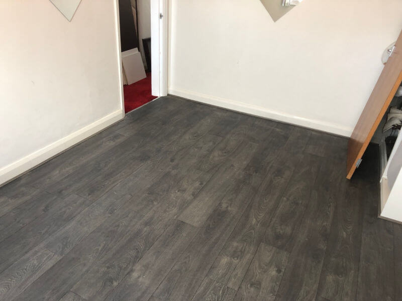 Laminate Flooring Fitted in Small Bedroom
