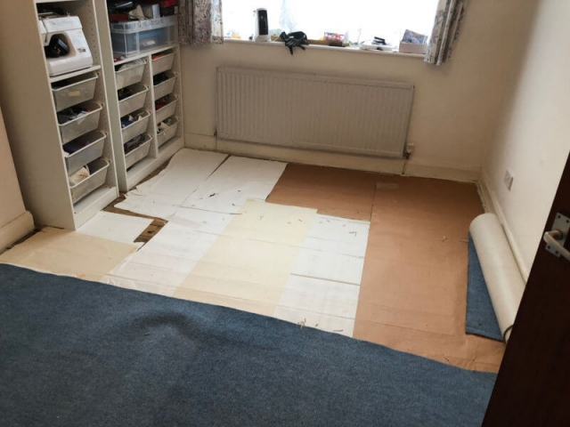 Old Flooring in Small Bedroom