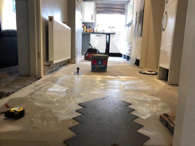 New luxury vinyl tile flooring being fiited