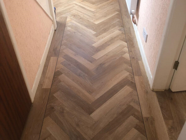 Karndean Pale Limed Oak fitted in lounge dinner and parquet planks fitted in hall