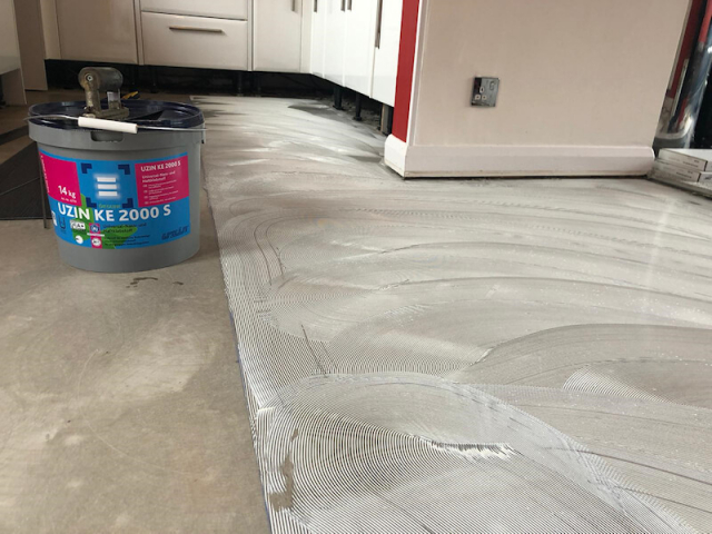 Luxury Vinyl Tile being fitted in Marple